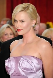 Charlize looked vintage Hollywood glam at the 2010 Oscars with a chic chignon that revealed her large diamond earrings.