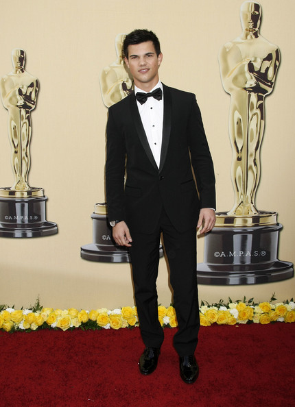 Hello Handsome! Taylor made the ladies swoon in a classic tailored tuxedo with patent oxfords.