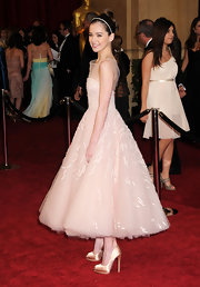 Hailee Steinfeld looked like a modern day princess at the 2011 Oscars in champagne double platform peep toes.