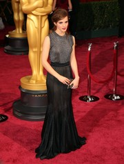 Emma Watson looked ultra sophisticated in a black sleeveless gown with a shimmering bodice and velvet skirt at the 2014 Academy Awards.