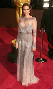 Angelina Jolie radiated in an embellished sheer gown at the 2014 Academy Awards.