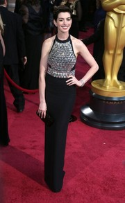 Anne Hathaway sparkled in a black Gucci halter gown with a bejeweled bodice at the 2014 Academy Awards.