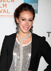 Haylie Duff paired her sequin top and black blazer with a cute pair of chain earrings. While she looked cute we would have left the skinny scarf at home.