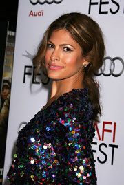 Eva dazzled in her sequin colored dress she showcased her sparkling dress with a loose center part ponytail.