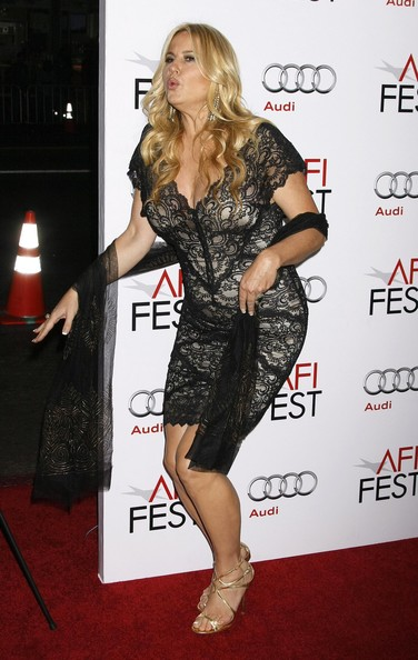 Jennifer wore the metallic Lance sandals with a lacy black cocktail dress.