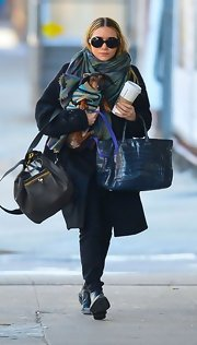 Ashley Olsen and her pup got bundled up for a walk in New York City. Ashley wore this oversize coat for the occasion.