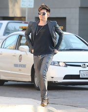 Adam Lambert stuck to his glam-rocker style with this leather jacket with puffed shoulders for his casual daytime look.