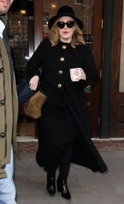 Adele sealed off her cold-weather ensemble with a pair of black ankle boots.
