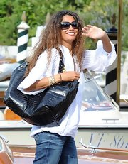 Afef was spotted out and about at the Venice Film Festival toting a reversible alligator bag. A nice touch to a casual outfit!