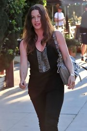 It's been quite some time since we've heard or seen Alanis anywhere, but she came out of hiding in Santa Monica wearing a cute leather shoulder bag.
