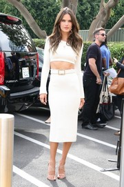 Alessandra Ambrosio teamed her crop-top with a white Calvin Klein pencil skirt for total sexiness.