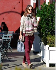 Alessandra Ambrosio grabbed coffee wearing a lila blanket scarf by Scarves.net that she paired with red jogger pants and a classic v-neck by Grey State.