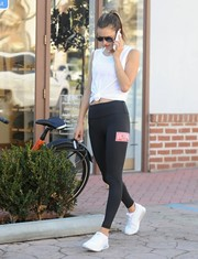 Alessandra Ambrosio donned a white tie-waist tank top for her workout.