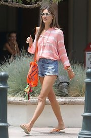 Alessandra Ambrosio's peach button down featured a cool tie dye design, just perfect for a sunny day.