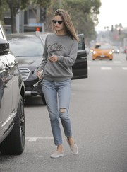 Alessandra Ambrosio went out and about in Santa Monica dressed down in a gray 'Coffee' sweater and ripped jeans.