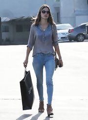 Alessandra Ambrosio traded in her Victoria's Secret angel wings for a more relaxed look with this slouchy button down.