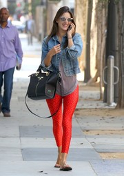 Alessandra Ambrosio was spotted in Santa Monica wearing a denim jacket over her Pilates outfit.