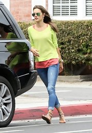 Alessandra Ambrosio chose a lime green netted sweater for her colorful casual look while out with her son in Cali.