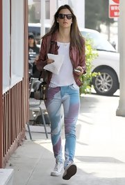 Alessandra Ambrosio chose a pair of pastel, print skinny jeans for her casual and cool daytime look.