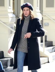 Alexa Chung looked toasty in a gray turtleneck layered under a black coat while out and about in New York City.