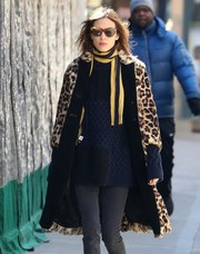 Alexa Chung kept warm with a yellow and black striped scarf paired with a leopard-print fur coat while out in New York City.