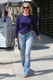 Ali Larter showed that casual-wear can be classy with this purple crewneck, which she tucked into her flare jeans.