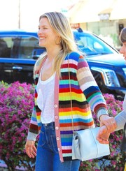 Ali Larter embraced color with this pastel-blue chain-strap bag and rainbow cardigan combo.