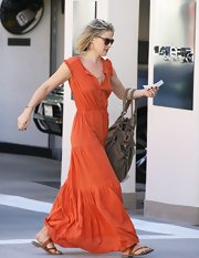 Ali Larter was chic in a burnt orange maxi dress topped off with tan flat sandals.