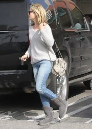 Ali Larter paired her gray sweater with gray sheepskin boots for an extra comfy look while out shopping.