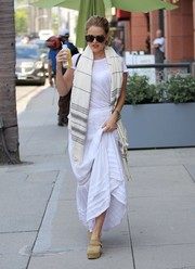 Alice Eve kept it simple up top in a plain white tee while out on a juice run.