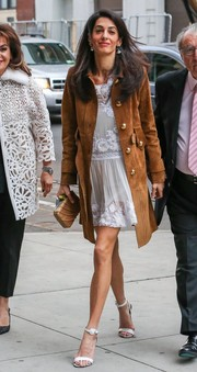 Amal Clooney layered a tan Gucci suede coat over an Alberta Ferretti LWD for a theater date with her parents.