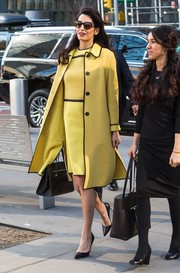 Amal Clooney- who was at the United Nations to urge the organization to back an investigation into crimes committed by the Islamic State in Iraq-  looked elegant in this yellow and black coat and dress combo by Bottega Veneta at the UN Headquarters in New York City.