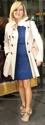 Amanda Holden stepped out of her Manchester hotel in platform pumps with ankle straps and ruffle detailing.