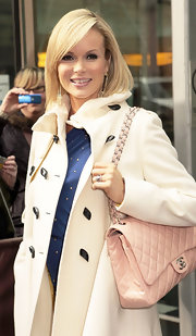 Amanda Holden carried a classic baby pink Chanel shoulder bag.