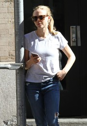 Amanda Seyfried lounged about under the New York sun wearing a pair of Saint Laurent shades.
