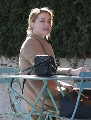 Amber Heard accessorized with a studded black shoulder bag while out in Los Feliz.