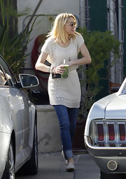 Amber Heard wore this cream sweater dress over her jeans for running errands in Hollywood.