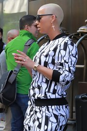 Amber Rose spent some time in NYC with her ultra-long stiletto nails painted a pearly hot pink shade.