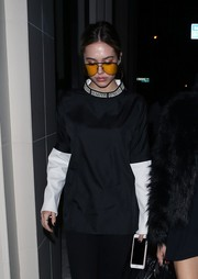 Delilah Hamlin was sporty in a long-sleeve black-and-white T-shirt by P.E Nation while enjoying a night out at Catch.