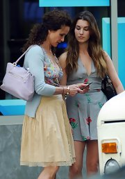 Actress Andie MacDowell is spotted out with her daughter carrying a violet tote bag.