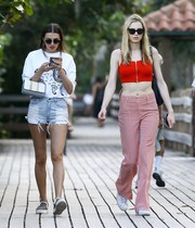 Andreja Pejic sealed off her cute outfit with red houndstooth pants.