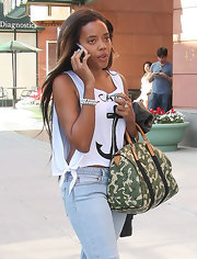 Angela Simmons gave her casual threads a military vibe with a camouflage bowler.