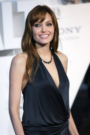 Angelina showed off her long locks and soft bangs while hitting the Berlin premiere of 'Salt'.