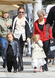 Angelina Jolie enjoyed a day with Brad's mom and the twins in a sheer tie-neck blouse and black skinny jeans.