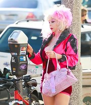 Angelyne's love for all things pink was evident all the way down to her metallic pink tote.
