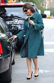 Ann Curry looked totally polished in her green coat and two-tone cap-toe platform pumps by Christian Louboutin during a meeting in New York.