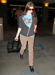 Anna Kendrick looked casual at LAX in a pair of black leather lace up wedge boots.