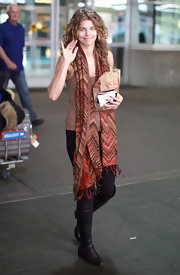 AnnaLynne McCord looked lovely at LAX wearing an ultra-casual outfit completed with comfortable knee-high boots.