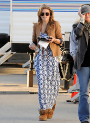 AnnaLynne kept comfy in tan sheepskin boots complete with fringed detailing.
