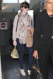 Anne spiced up her brown sweater with a colorful floral scarf.